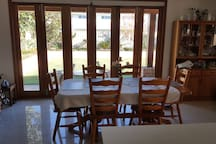 DINNING ROOM WITH VIEW OF BEAUTIFUL BACKYARD GARDENS