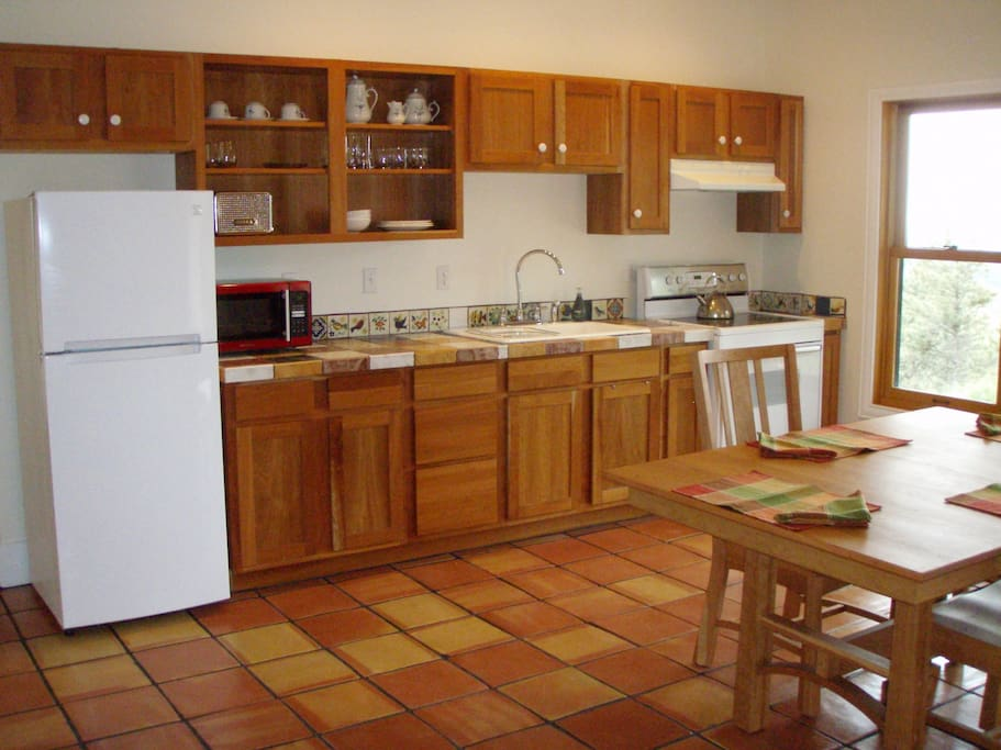 The 1050 square foot apartment has a full kitchen with microwave and electric oven.