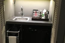New sink/faucet in wet bar; trolley with nespresso coffee machine cups/dishes etc