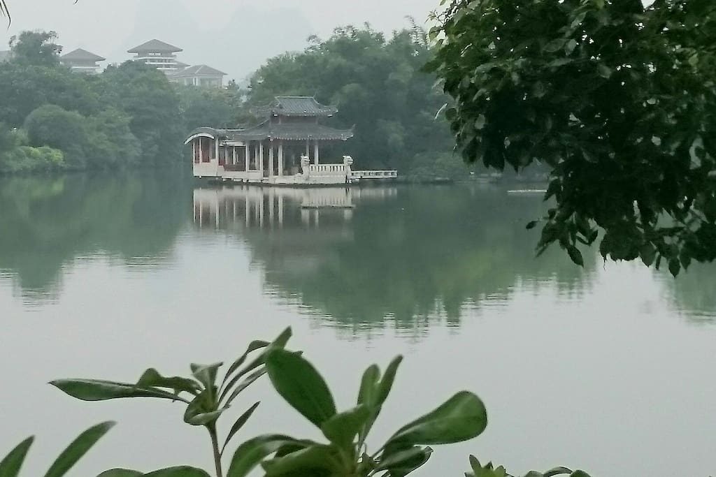 "This is the lake near our house, called ""Rong Hu""lake. Every morning, you can have a walk here to see the local elderlies are doing exercise and having breakfast."