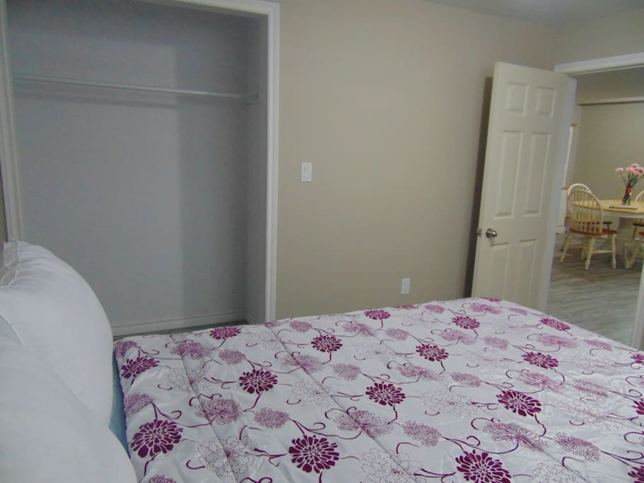 Bdrm 2 Queen size bed and closet with dresser.