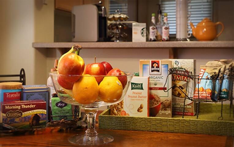 Healthy Breakfast Bar with organic coffee and tea, fresh fruit, yogurt, oatmeal or granola bar.