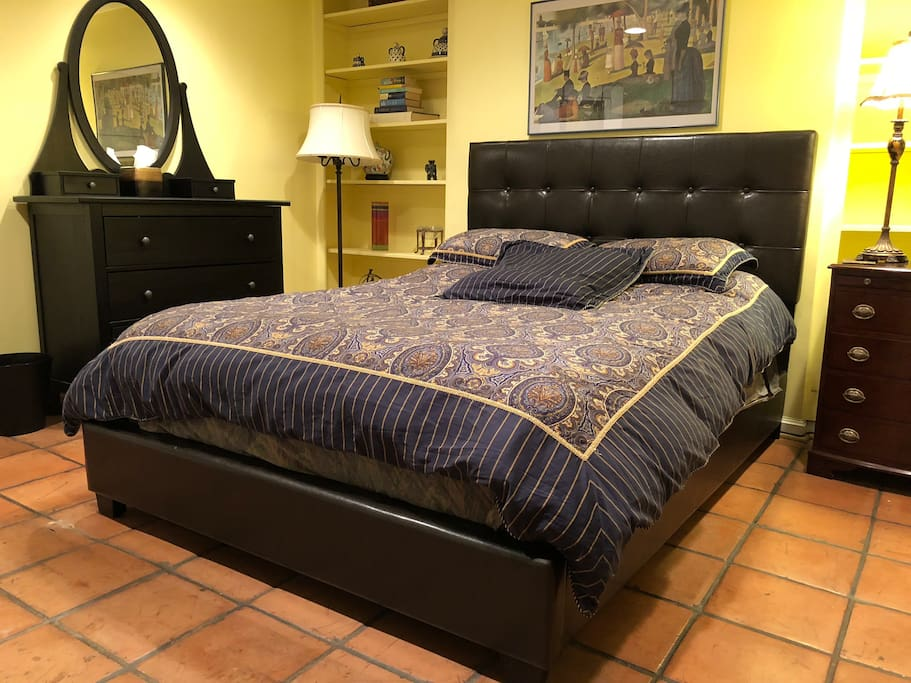 Comfortable queen size bed with flat screen TV and large closet.
