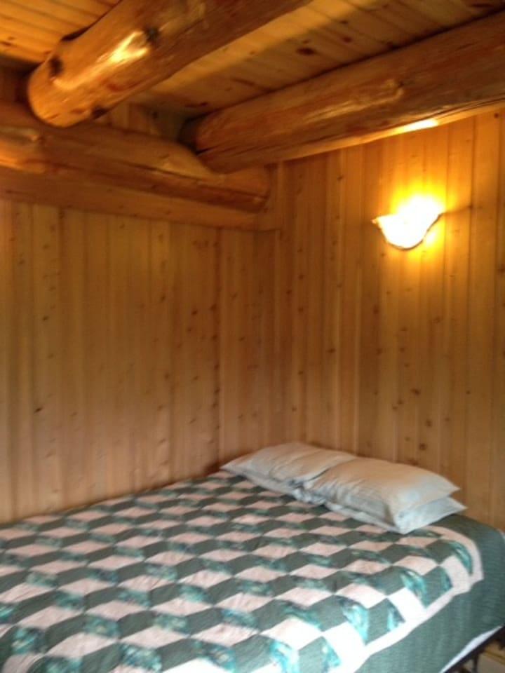 Queen size bed in master bedroom.