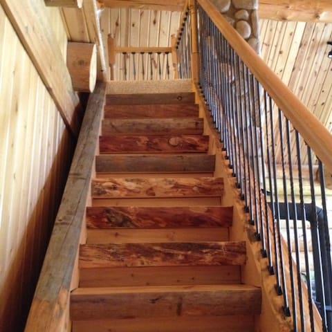 Half log stairway to loft.
