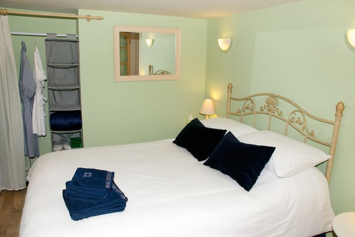 Your own bedroom with a new ( Feb 2017 ) 4'6'' double bed. Fresh linen, duvet , 4 pillows, towels ,robes and slippers provided. Ample hanging and clothes storage space . Extra blankets /throws. Hairdryer.Night light. TV, radio , alarm clock .