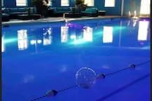 """Olympic Sized Indoor heated pool. Locker room """"Sauna for adults only"""" and a Bar and Grill area."""