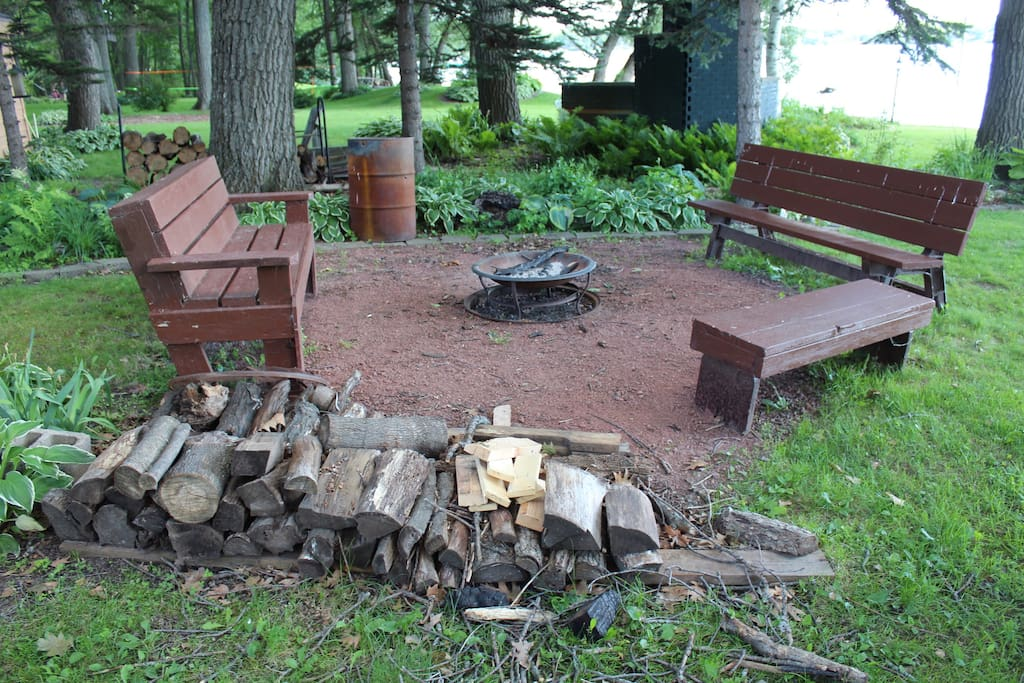 Fire pit with sitting areas and firewood