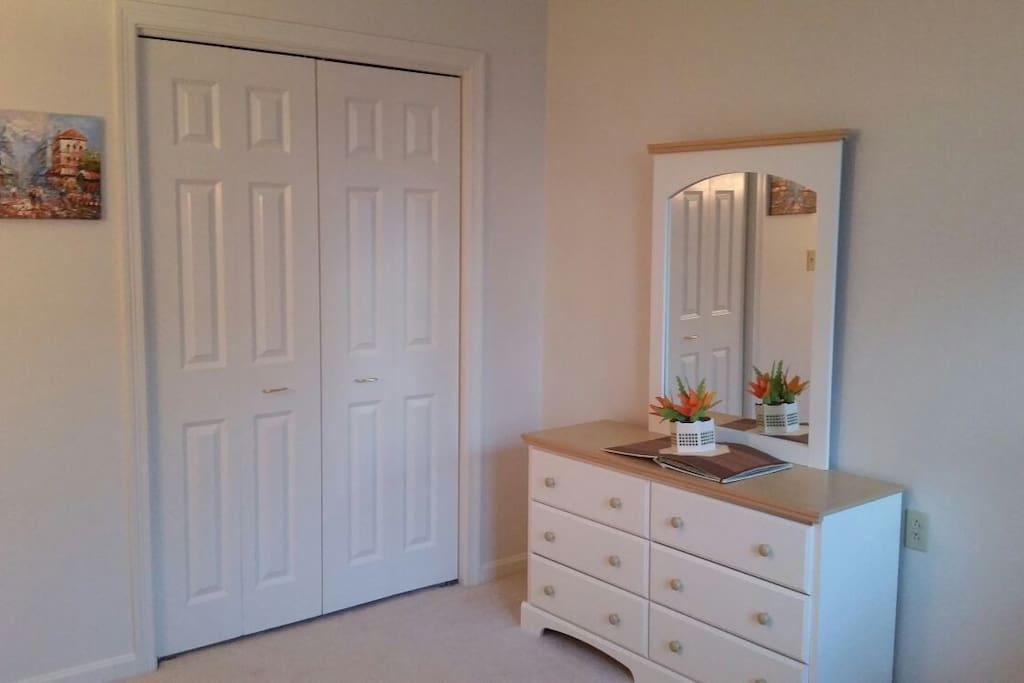 The room has a walk-in closet and a neat and nice dresser available for you to use if you desire.