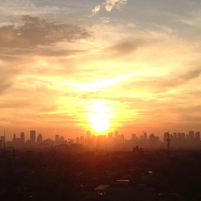 The morning view: sunrise with city silhouette