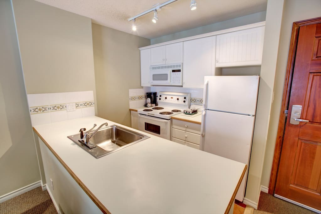 Enjoy the use of the fully-equipped kitchen.