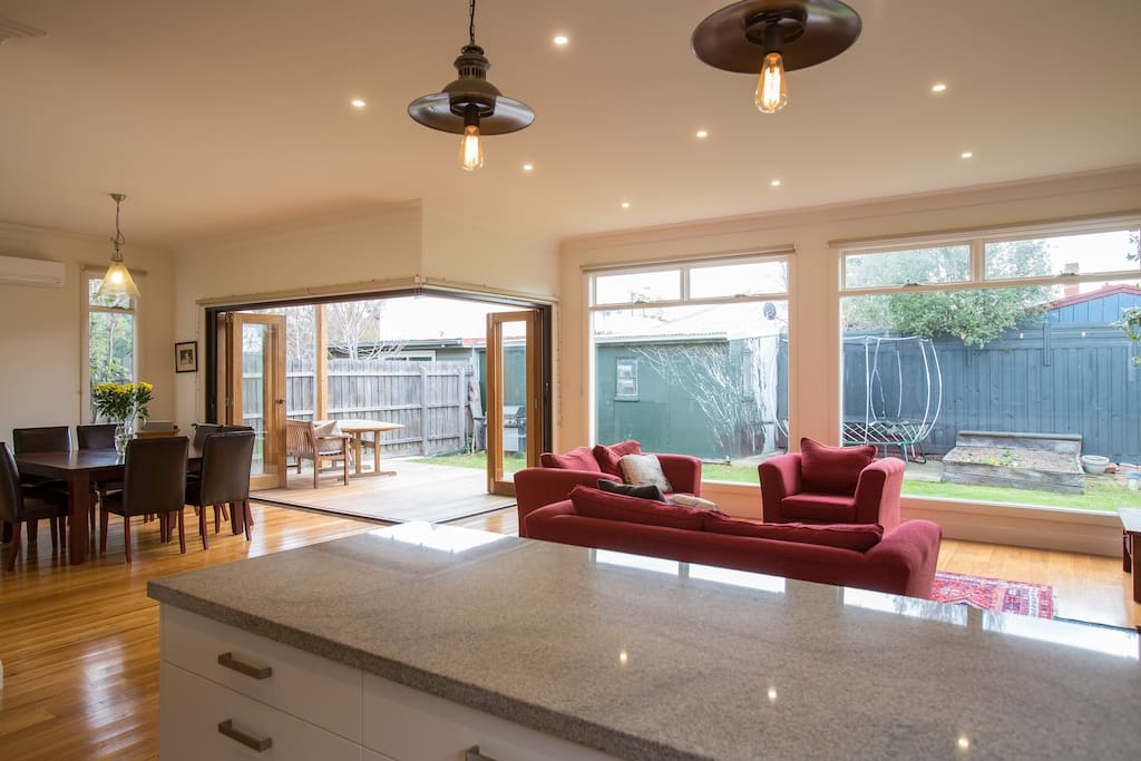 Large open plan living with big backyard, including Springfree Trampoline for the kids.
