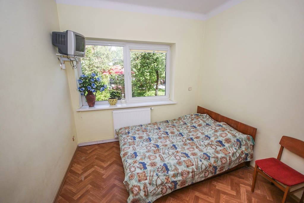 Room for two with TV, table, wardrobe in first floor of private house.