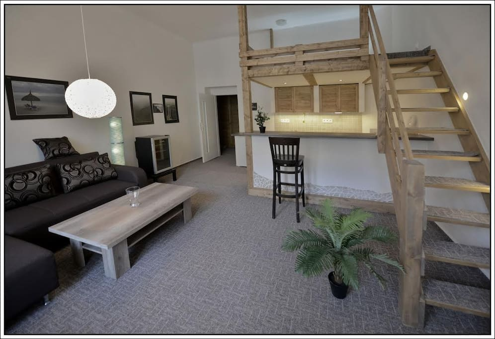Above the living room is a bedroom with a double bed