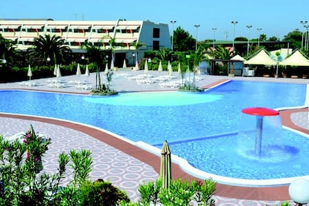 Casa in residence con vista piscina - Lido
