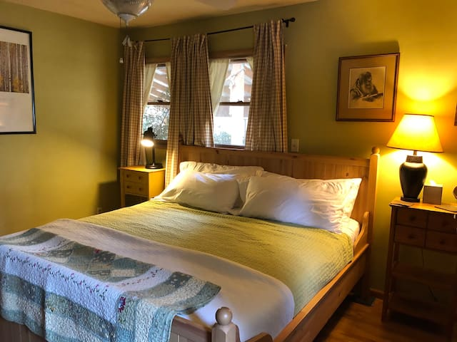 Relax in the master bedroom with super comfy king bed and cotton bedding after a long day of exploring Stumptown.