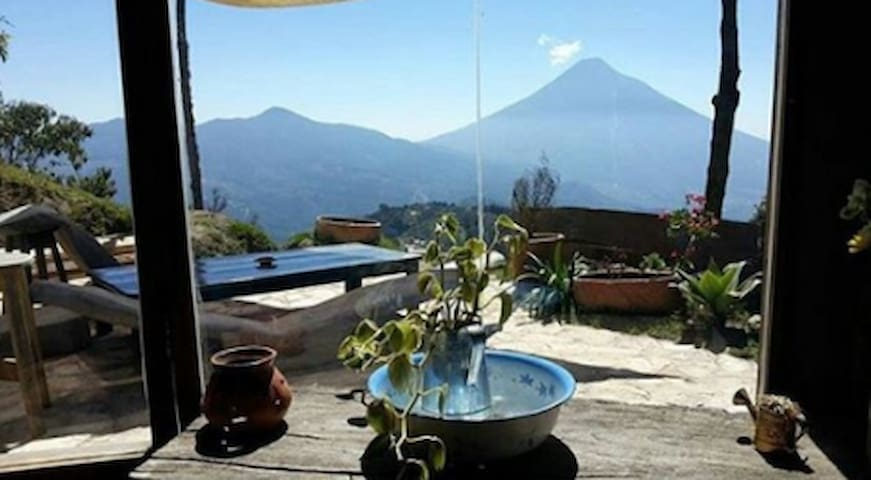 The view from your window looking out over the valley and straight to Antigua's 3 neighbor volcanos.