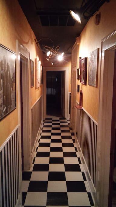 Hallway with trumpet spot lights.
