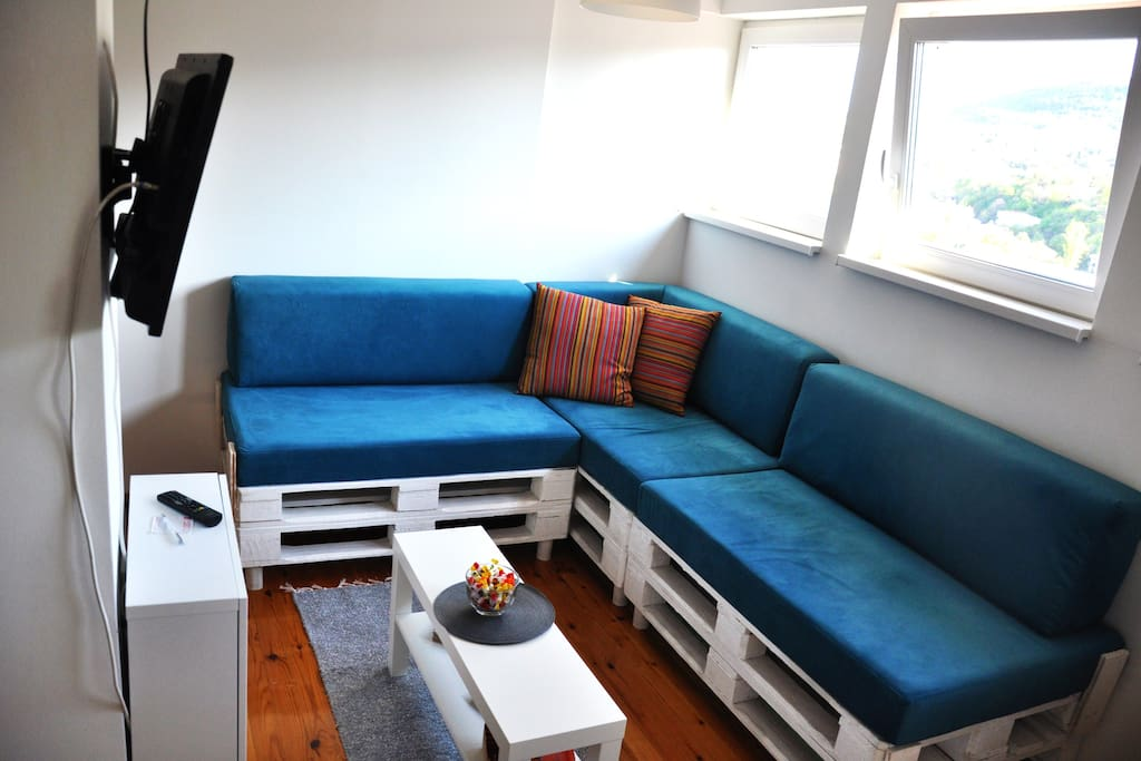 Living room with funky sofa made of white pallets