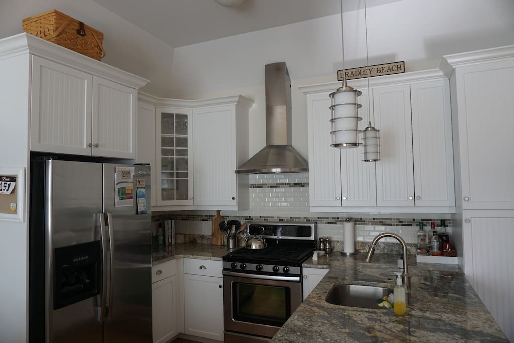 Beautiful open kitchen with stainless steel appliances including dishwasher.  Toaster oven, pots & pans included