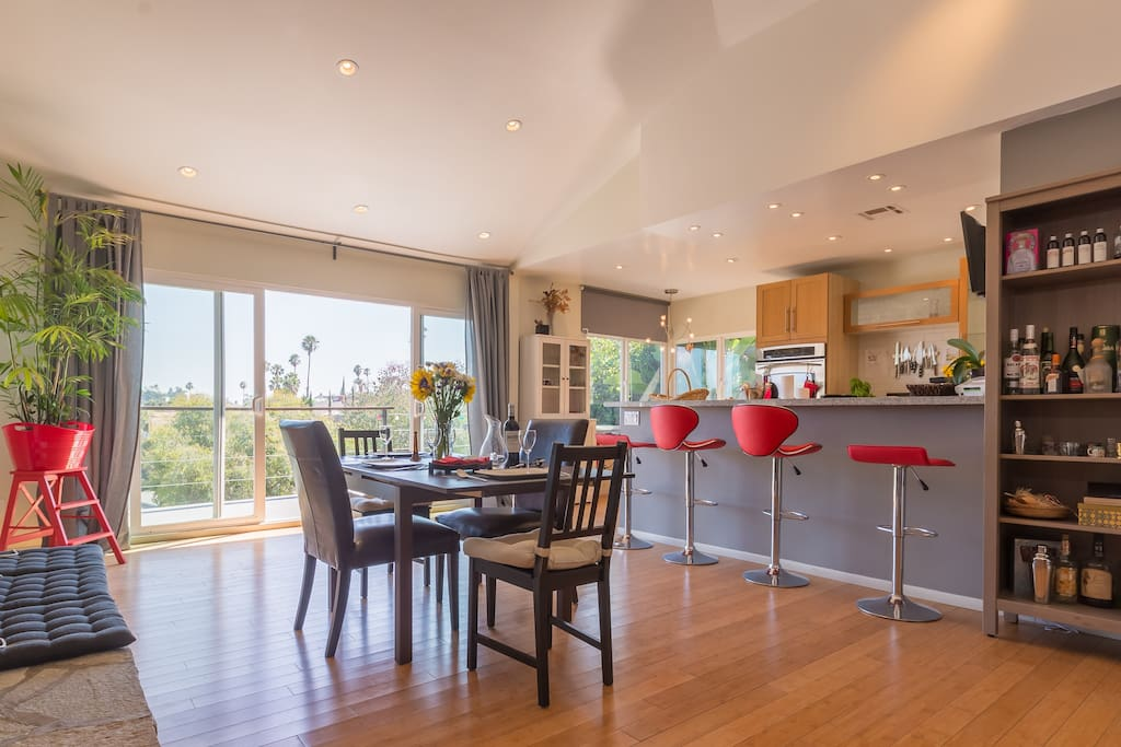 The kitchen, bar and dining is a large open area, perfect for sharing drinks/meals or a couple cooking together!