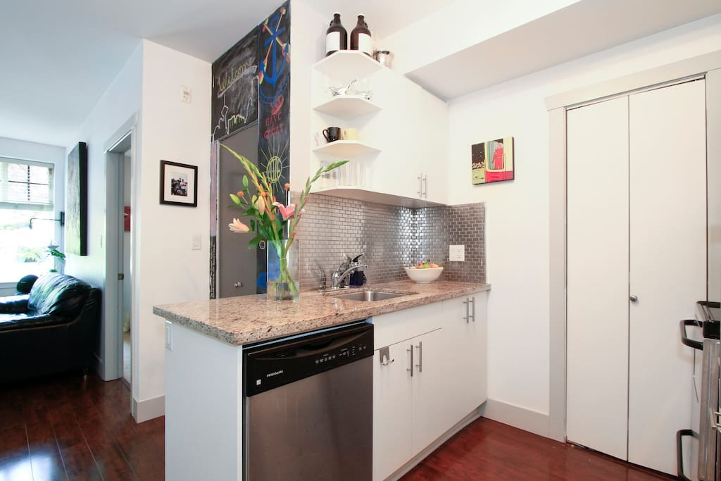 Kitchen with all amenities including a dishwasher.