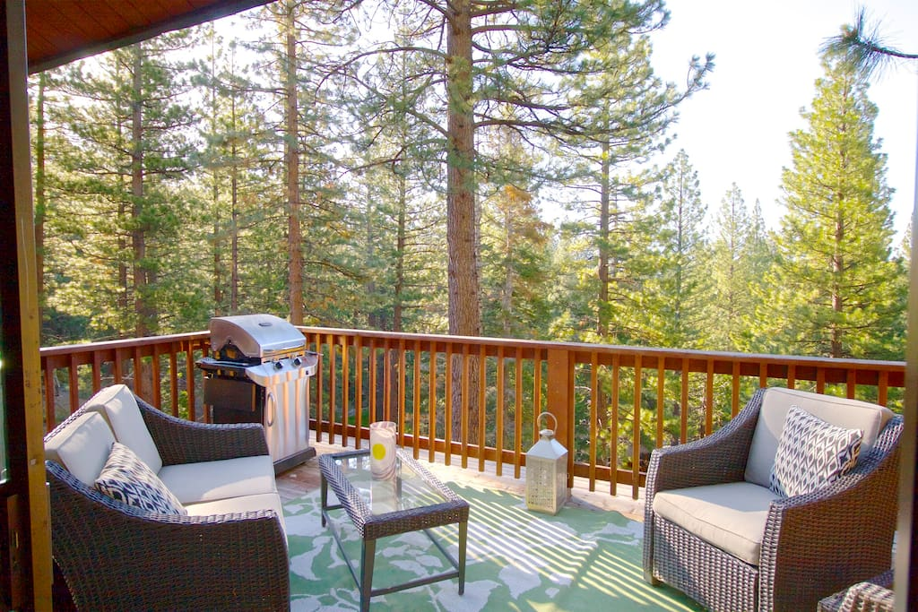 Back deck with peek lake views.  Propane bbq and outdoor seating.