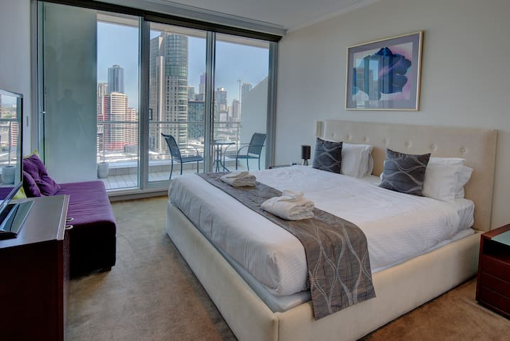 The master bedroom has a king bed and ensuite, with a balcony overlooking the river