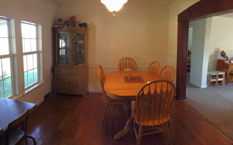 Expandable dining table with room for 12. Two children's tables. One high chair and two booster seats available upon request.