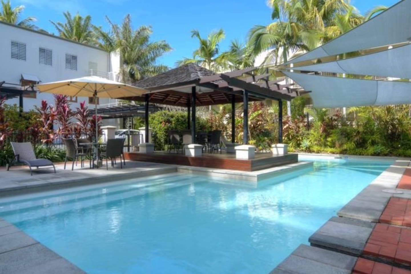 resort pool, gazebo, BBQ and spa just down the stairs