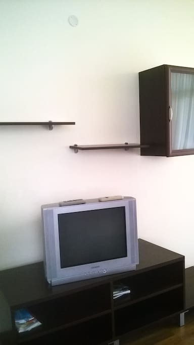 Living room: cable TV set on a TV shelf, where you can place your gadgets, etc.