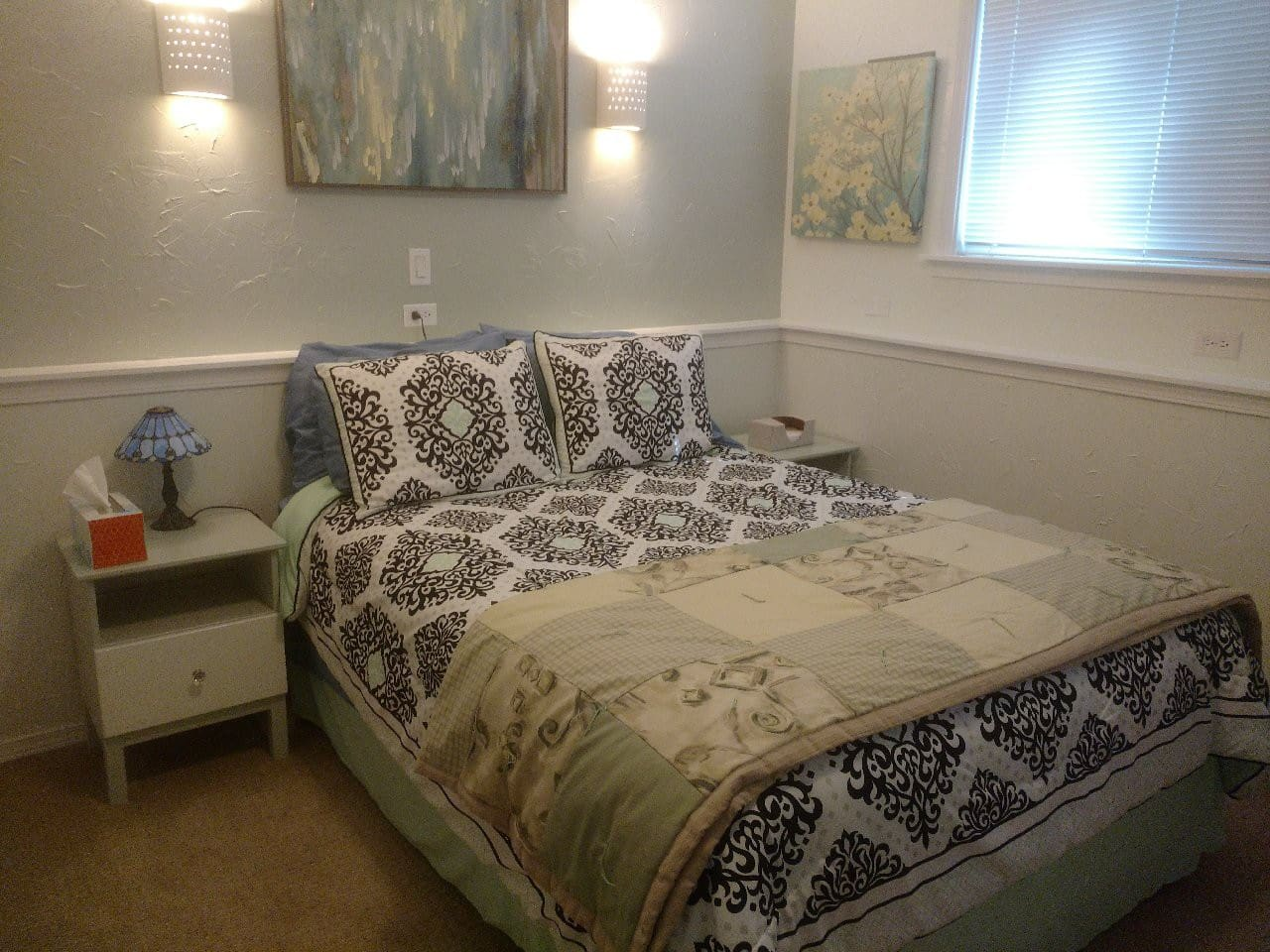 Newly remodeled bedroom; queen bed and a private 3/4 bathroom.