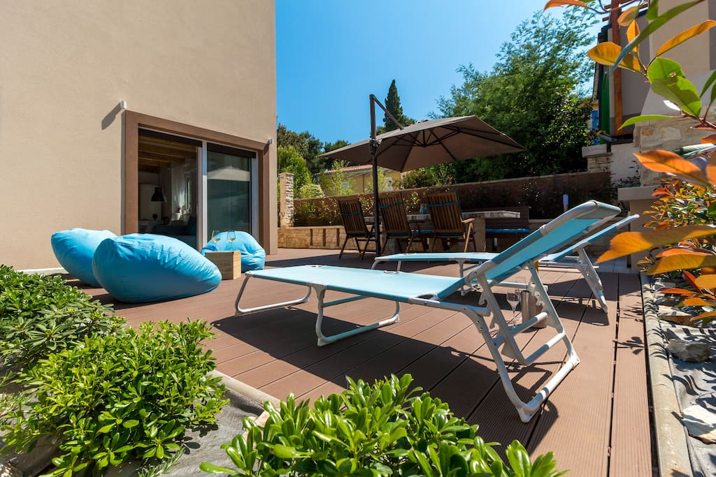 Private terrace is equipped with barbecue, summer kitchen, 3m long table with bench and 6 chairs, 4 loungers and 3 lounge armchairs and outside shower