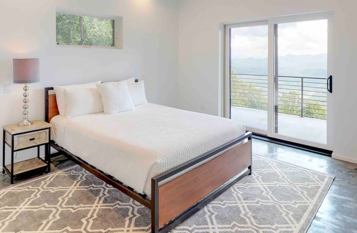 2nd bedroom with private bathroom, large deck with gorgeous views! Located on the lower level of the home