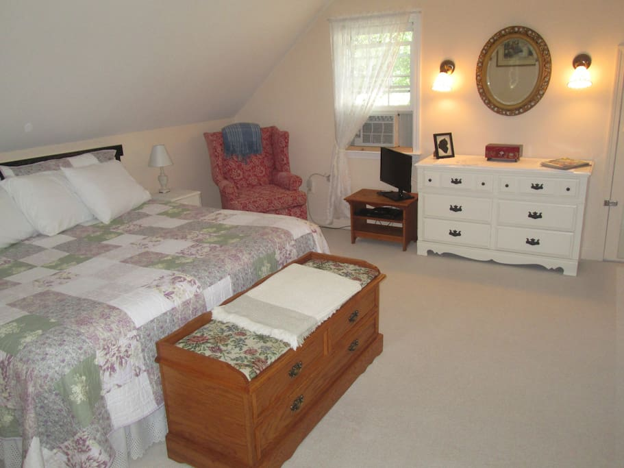Spacious Sandpiper Room with king size bed, a desk, and a love seat