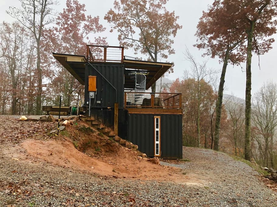 The side view of the cabin shows off the new sloped roof that'll keep you dry while you enjoy the front and back decks.