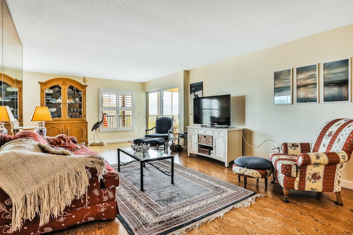 Spacious third floor condo with Gulf views, screened-in porch, and shared pool!