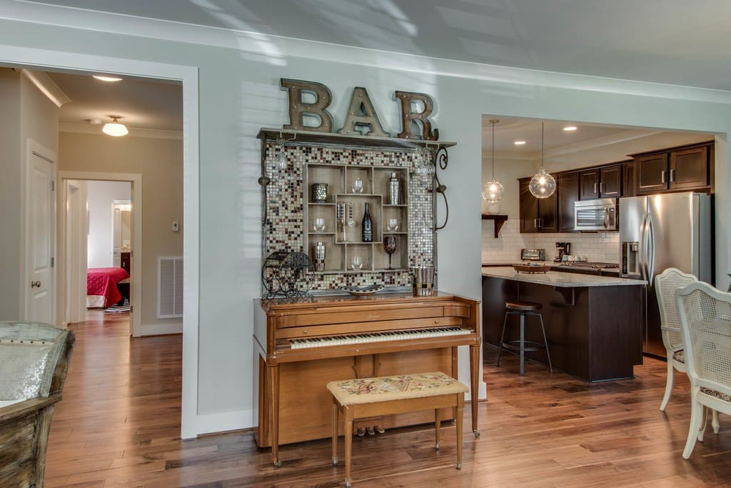 One-of-a-kind Nashville style, with hardwood floors and handmade/refinished furniture.