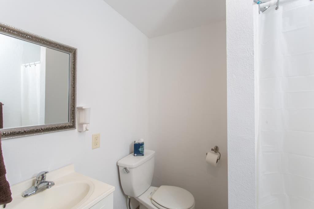 Bath with walk-in shower, towels,space heater