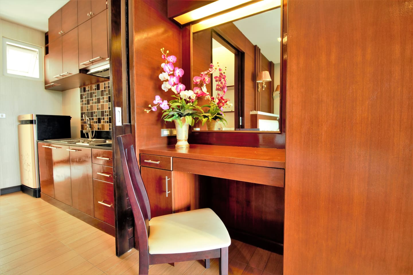 Vanity desk for your daily make-up and sliding doors to separate the kitchen