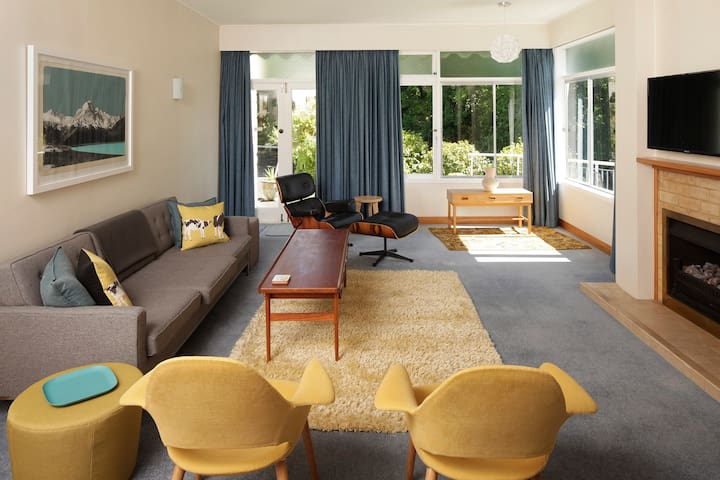 Mid-century furniture, gorgeous views, beautiful art and super host status, in this unique immaculate Whanganui bespoke home.