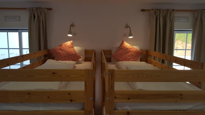 7 bed dorm in Sunshine Hostel w balcony connection