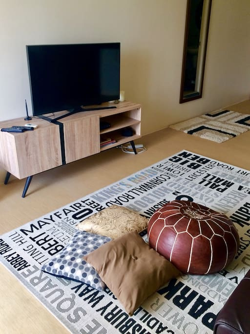 Get cozy on the carpet with this Moroccan poof and throw pillows.  Full HD TV is connected to ABS-CBN tv box for your local tv channels.