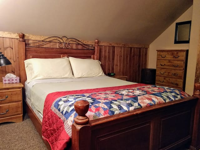 Upstairs Bedroom with Queen size bed and TV.