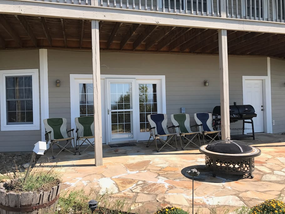 Suite entrance (back of home)  Patio with Fire pit and Gas Grill  Main entrance with Key Code