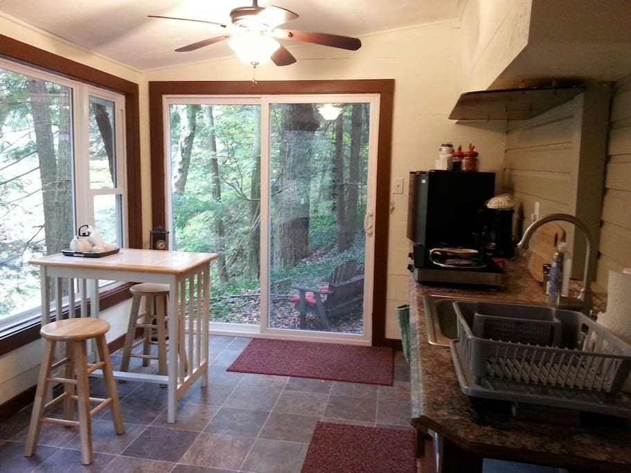 Kitchen with propane stove and mini-fridge