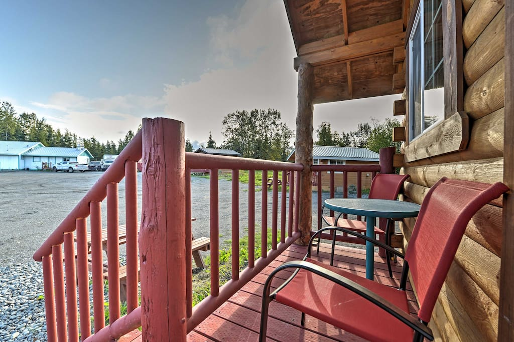 Relax on the furnished front porch and soak in the peaceful surroundings.