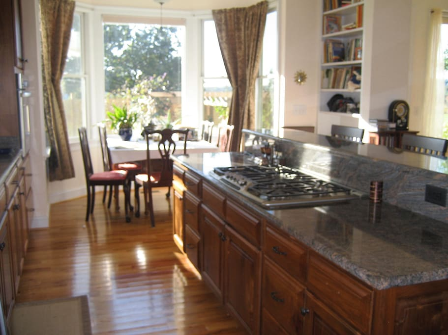 Kitchen has quiet Bosch DW, grant counters, 5 burner gas stove top, convection oven