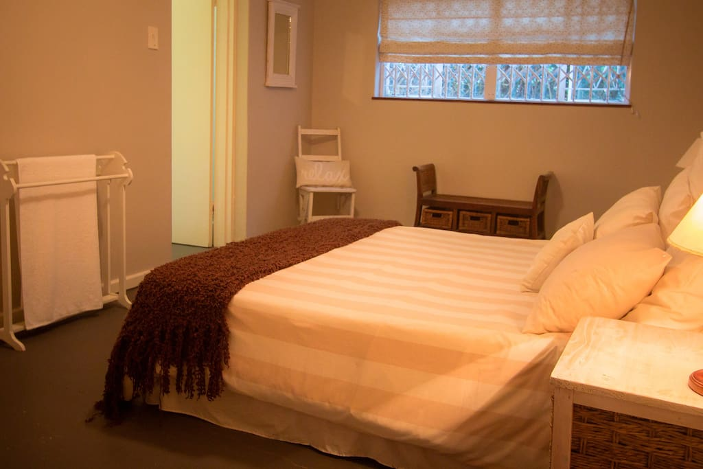 Main bedroom with full en-suite bathroom decorated with a beach house look.