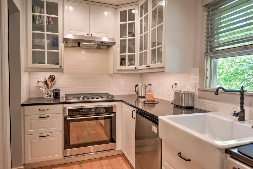 The beautiful kitchen features stainless steel appliances and is perfect for preparing a delicious meal.